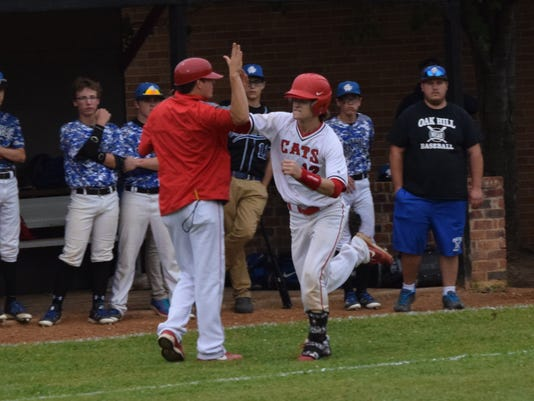 Glenmora's Cameron Strother (12, right) high-fives third base coach and head coach Aaron West on his way to home plate after hitting a two-run homerun against Oak Hill Tuesday.