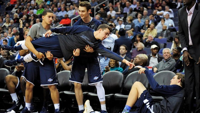 The Monmouth Bench Mob, shown here at Georgetown last season, helped springboard the Hawks into the national conversation last season