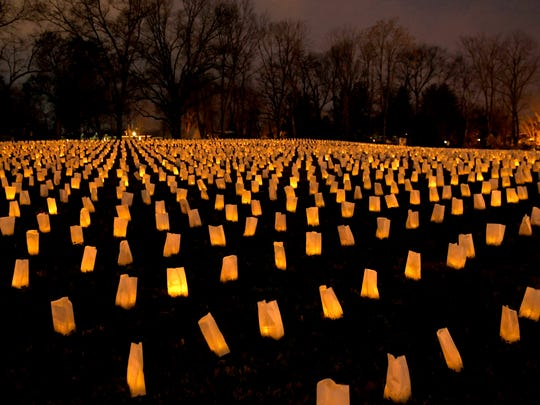 Each year on November 30th, The Battle of Franklin Trust hosts the annual Illumination where ten thousand luminaries are laid out to represent the 10,000 casualties from the Battle of Franklin in 1864. People walked among the luminaries at the Carter House on Thursday, Nov. 30, 2017.