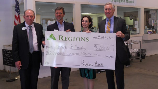 Pictured from left to right — Alan Noe: V.P. Mortgage Production Manager, Regions Bank; Larry Peterson: Executive Director, HFHS; Brandi VanAntwerp: Development Director, HFHS; Ron Hawley: Springfield Market President, Regions Bank