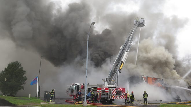 File photo: Smoke billows at Nolan's on Canandaigua Lake in Canandaigua in July.