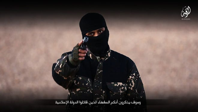 An image taken from a video published by the media branch of the Islamic State group in the Raqqa province on Jan. 3, 2016. The video purportedly shows an English-speaking fighter at an undisclosed location speaking to the camera before executing, along with four other jihadists, five men from the Syrian city of Raqqa.