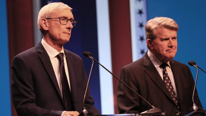 Tony Evers (left) and Matt Flynn are ready to debate Thursday, July 12, 2018, at the UW-Milwaukee  MainStage Theatre.