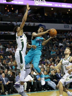 Hornets rookie Malik Monk  drives to the basket against the Bucks' Giannis Antetokounmpo on Wednesday night in Charlotte.