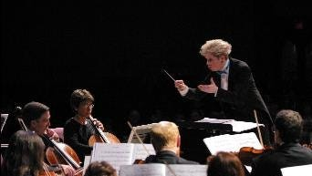 Conductor Nan Washburn leads the Michigan Philharmonic, which will perform Saturday with the National Arab Orchestra at Music Hall.
