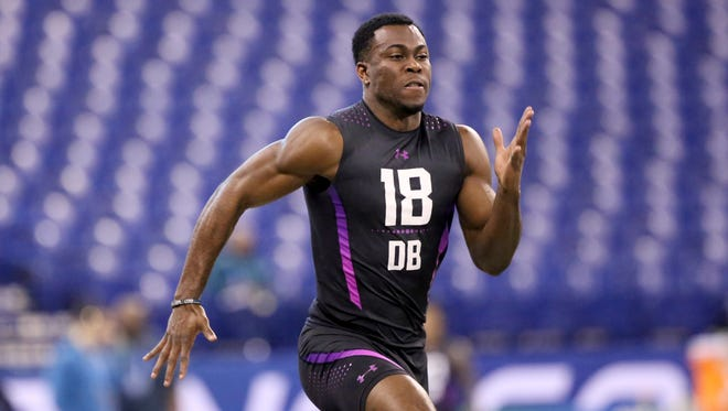 Iowa defensive back Josh Jackson runs the 40-yard dash at the 2018 NFL Scouting Combine on March 5, 2018, in Indianapolis.