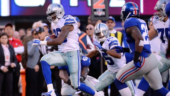 Dallas Cowboys running back Darren McFadden (20) runs against the New York Giants.