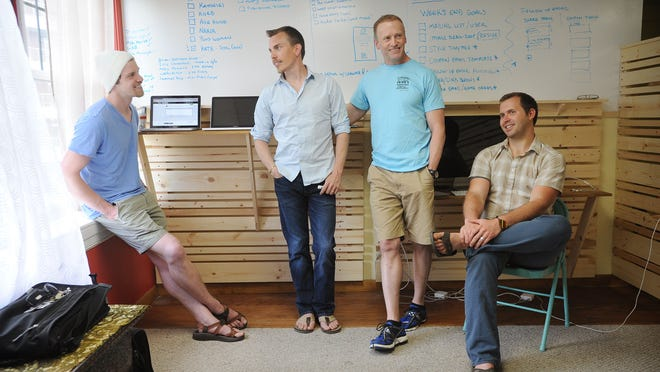 From left: Jacob Voigt, David Bentley, Chad Slagle, and Josiah Greenewald are the muscles and brains behind the new startup MobRocket. The company, which has a small office in downtown Asheville on Wall Street has goals to take down Groupon by creating company campaigns to help businesses reach new clients.
