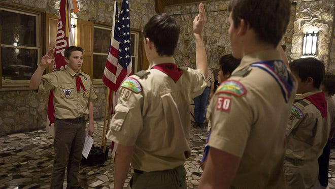 William Hurt leads Boy Scout Troop 50 in the scout oath Wednesday at Christ Community Church in Montreat before the start of their meeting.