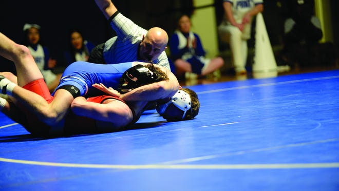 Jacob Beeson, 149 lbs, PCC, pins his opponet from Cowley County Community College during a Jan. 29 dual in Pratt. Beeson continues a successful run through NJCAA opponents, including a recent first-place finish in Miami, Oklahoma. Beeson and PCC teammate Michael Spangler are ranked nationally.