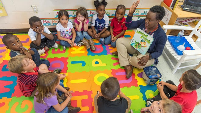 Pre-kindergarten teacher Rosalind Sandcroft works with her students at The Webster School in St. Augustine in this 2018 file photo. It's still unclear when in-person attendance in St. Johns County public schools will resume.