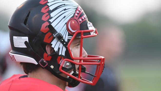 New Boston Huron's football helmet features a Native American headress. Huron is one of 43 high schools in Michigan that has a Native American nickname.