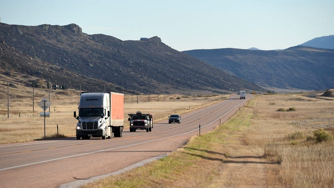 Vehicles drive north on U.S. Highway 287 between Ted's Place and Owl Canyon where the Northern Integrated Supply Project proposes to locate the 170,000 acre-foot Glade Reservoir. The project will require relocation of 7 miles of the highway.