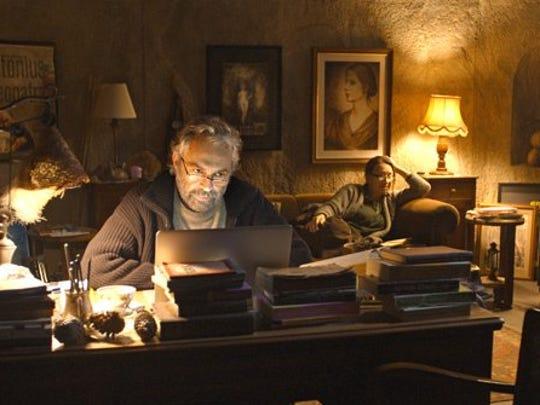 Necla (Demet Akbag, in background) is the divorced, bitter sister of hotel owner and former actor Aydin (Haluk Bilginer) who holds nothing back in her criticisms, especially of Aydin.