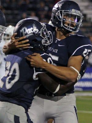 Nevada quarterback Tyler Stewart (15) right hugs running back James Butler (20) after his second-quarter touchdown against Buffalo at MacKay Stadium on Sept. 17, 2016.