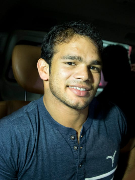 FILE- In this July 27, 2016 file photo, Indian wrestler Narsingh Yadav leaves after a hearing at the National Anti-Doping Agency (NADA) in New Delhi, India.  India's anti-doping agency has dropped charges against Yadav, clearing the way for him to travel to the Olympics in Rio de Janeiro. (AP Photo/Tsering Topgyal, File)
