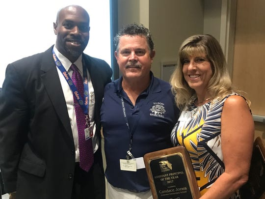 Superintendent Desmond Blackburn with Rick Fleming, principal of West Shore Junior Senior High School in Melbourne, and Candace Jones, assistant principal at Hans Christian Andersen Elementary in Rockledge. Fleming and Jones were named Brevard Public Schools' principal and assistant principal of the year on Tuesday.