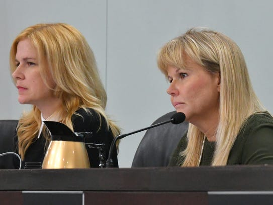 District 5 Commissioner  Kristine Isnardi, left, is