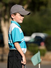 Jackson Merriss, 8, plays golf at the Smithfields Country Club on Wednesday, Oct. 5, 2017.