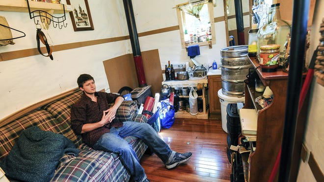 Rob Dunn lives in a two-story, 96-square-foot home in Poultney, Vt. Dunn, a Green Mountain College senior from Henniker, N.H., has lived off the grid for about a year in his tiny home powered by two 100-watt solar panels.