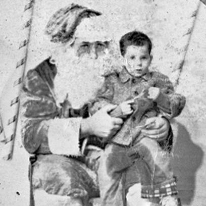 Billy Jones sits on Santa's lap in this 1961 photograph.