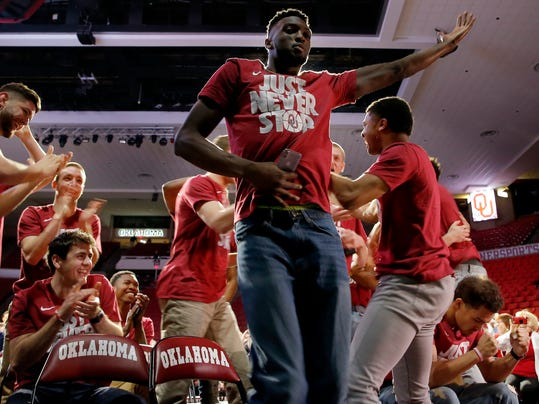 FILE - In this Sunday, March 11, 2018, file photo, Oklahoma's Khadeem Lattin celebrates during a watch party for the NCAA selection show at Lloyd Noble Center in Norman, Okla. Lattin, the lone senior on the team and the only starter left from the 2016 Final Four squad, gets one last shot to play in the NCAA Tournament. (Sarah Phipps/The Oklahoman via AP, File)