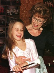 Bernie Matzke gives one of her baton students, Christine