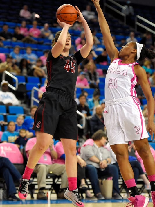 Washington State forward Borislava Hristova shoots as UCLA guard Nirra Fields defends during the first half of an NCAA college basketball game, Friday, Feb. 12, 2016, in Los Angeles. (AP Photo/Mark J. Terrill)