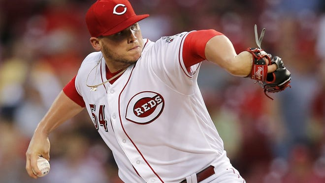 Cincinnati Reds starting pitcher Rookie Davis (54) delivers a pitch in the top of the second inning of the game between the Cincinnati Reds and the St. Louis Cardinals at Great American Ball Park on Sept. 20, 2017.