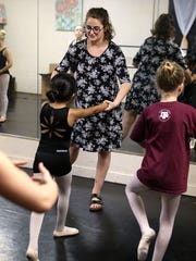 Home-schooler Emma Armstrong, a ballet instructor at the San Angelo Broadway Academy, helps her student with her form during ballet class Wednesday, May 16, 2018.