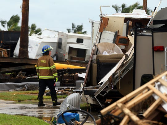 Port Aransas EMS Chief Tim McIntosh searches for stranded locals at an RV park after Hurricane Harvey on Saturday, August 26, 2017, in Port Aransas, Texas.