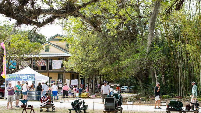 People check out old engines during the the Antique Engine and Quilt Show at Koreshan State Historic Site in Estero, on Sunday, March 19.