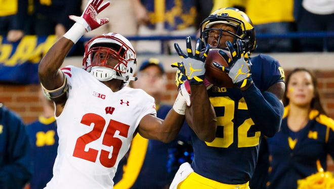Michigan wide receiver Amara Darboh (right) makes a touchdown reception in the fourth quarter of a 14-7 victory against Wisconsin last season.