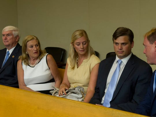 John Duncan III, second from right, sits with his attorney
