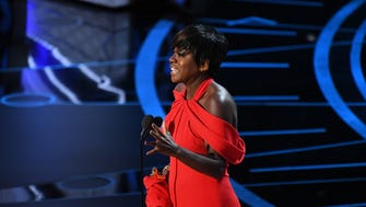 Viola Davis accepts the Oscar for supporting actress for her role in 'Fences' during the 89th Academy Awards.