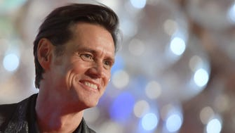 Jim Carrey is taking a hit on Twitter after sharing a portrait on March 17, 2018 that appears to be inspired by White House Press Secretary Sarah Huckabee Sanders.