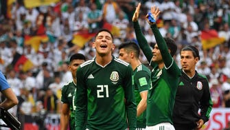 Mexico's defender Edson Alvarez (left) and teammates celebrate their 1-0 victory at the end of the 2018 World Cup Group F match against Germany at the Luzhniki Stadium in Moscow on June 17.