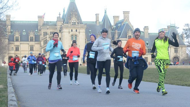 About 1,300 runners braved extreme weather conditions during the inaugural Asheville Marathon at the Biltmore Estate. This year's event is Sunday.