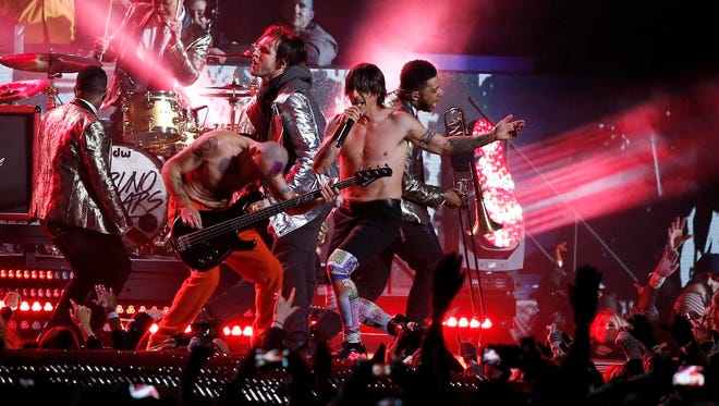 The Red Hot Chili Peppers perform during the halftime show of the NFL Super Bowl XLVIII football game between the Seattle Seahawks and the Denver Broncos Sunday, Feb. 2, 2014, in East Rutherford, N.J. (AP Photo/Kathy Willens)