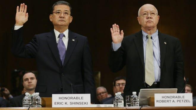 Veterans Affairs Secretary Eric Shinseki and Veterans Affairs Undersecretary for Health Robert Petzel are sworn in before testifying Thursday.