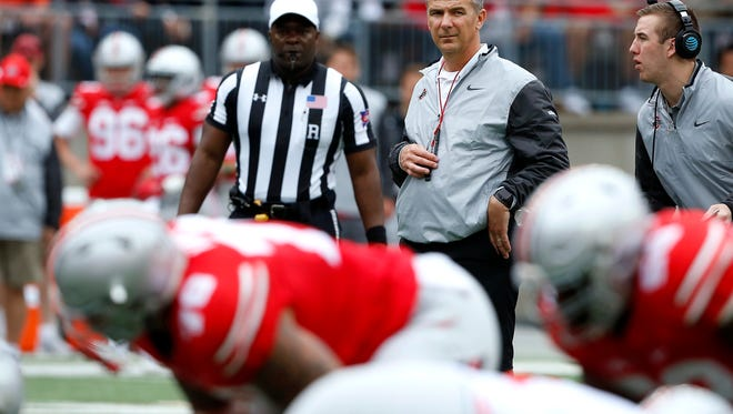 Ohio State coach Urban Meyer is looking to put his Buckeyes in the playoffs for the third time in four years.