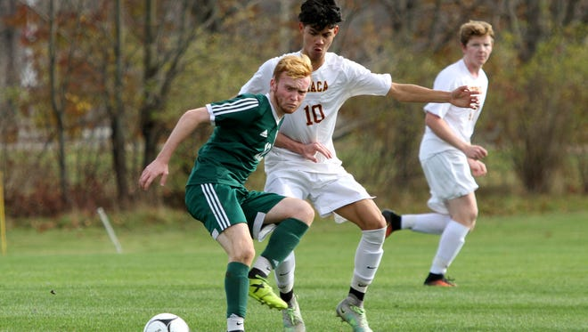 Ithaca's Roberto Mier is held off the ball by Patrick Boyle during Saturday's NYSPHSAA Class AA regional final at Wright National Soccer Campus in Oneonta. Mier scored the game-winner in the final seconds, giving the Little Red a 2-1 win.