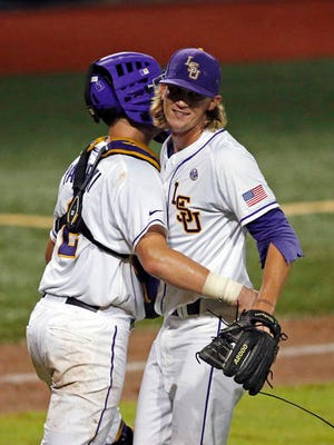 LSU pitcher Hunter Newman celebrates with catcher Michael Papierski (2) after they defeated Rice in a college baseball regional tournament in Baton Rouge.