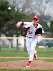 Port Clinton's Trevor Frias pitches during the Redskins