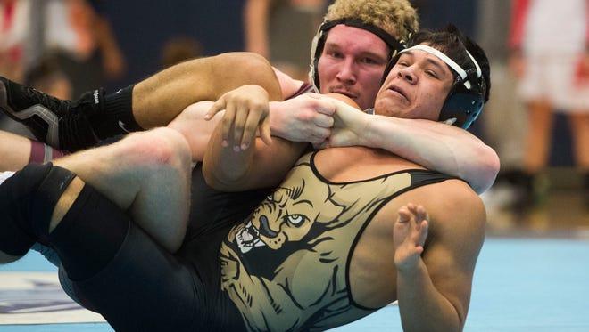 Bearden's Max Grayson wrestles Stone Memorial's Elmer Estrada during the individual regionals Saturday at Hardin Valley Academy.