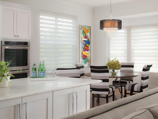 The bay window in the kitchen dining area provides