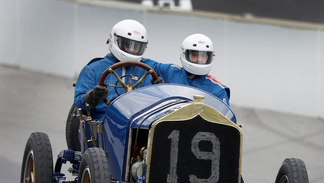 Brian Blain drives the 1911 National Speedway with Charles Test,right, during the SVRA Brickyard Vintage Racing Invitational Sunday, June 19, 2016, at the Indianapolis Motor Speedway.