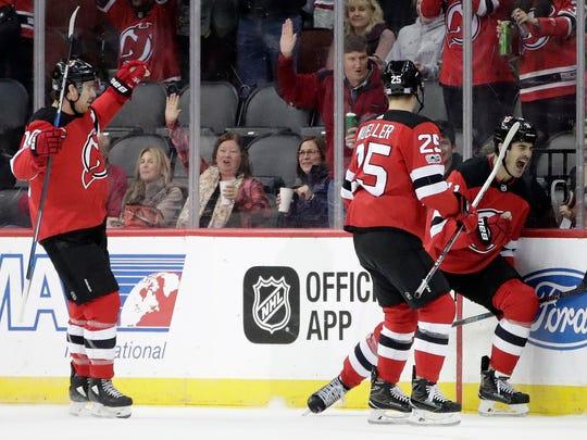 New Jersey Devils center Brian Boyle, right, celebrates