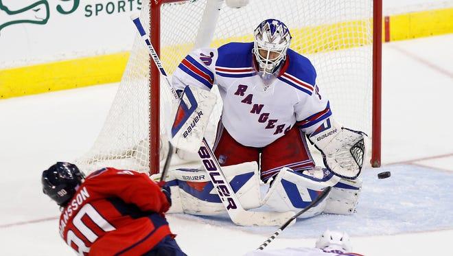 New York Rangers goalie Henrik Lundqvist (30) makes a save on Washington Capitals center Marcus Johansson (90) in the third period at Verizon Center.