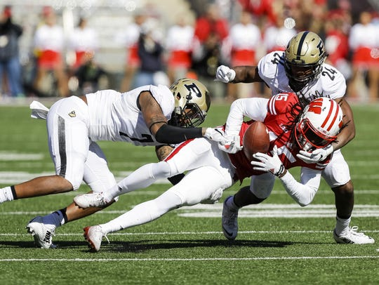 Purdue safety Robert Gregory (7) and cornerback Frankie